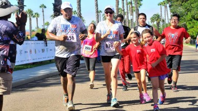 A large team crosses the finish line of the Marine Boot Camp Challenge. Photo by Chris Stone
