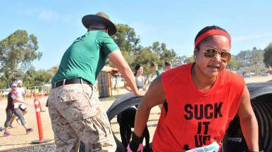 A runner's shirt expresses her emotion as she makes her way through the Boot Camp Challenge at MCRD. Photo by Chris Stone