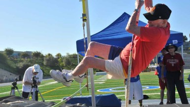 Pellmann tries to clear a height in the pole vault at the Senior Olympics meet at Mesa College. Photo by Chris Stone