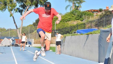Pellman sets a world record in the M100 age group in the long jump. Photo by Chris Stone