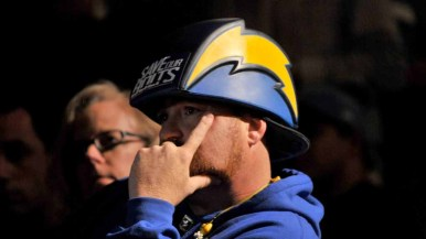 A fan listens to speakers at the NFL forum downtown. Photo by Chris Stone