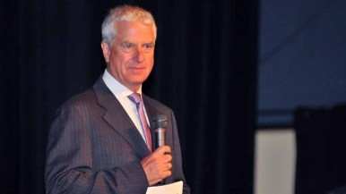 Mark Fabiani, a lawyer for the San Diego Chargers, waited to speak while the crowd booed him. Photo by Chris Stone