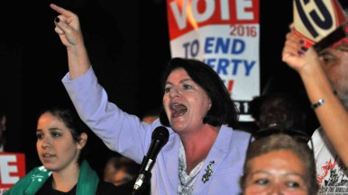 Assembly Speaker Toni Atkins speaks at a rally calling for $15 minimum wage. Photo by Chris Stone