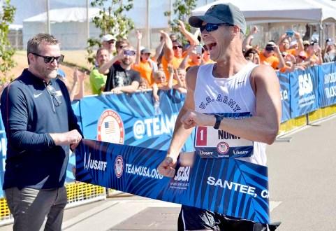 John Nunn celebrates winning men's Olympic Trials 50K race walk. USATF Director of Events Jim Estes holds the tape. Photo by Ken Stone