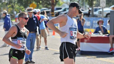 John Nunn checks his split at the finish-line turn of men's 50K Olympic Trials race walk. Photo by Ken Stone