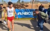 John Gastaldo of The San Diego Union-Tribune focuses on men's 20K winner Manuel Corvera, a recent San Diego State University graduate. Photo by Ken Stone