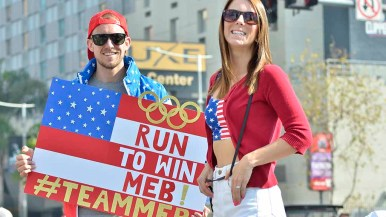 Andrew Falkiewicz and fiancee Allie Applegate, neighbors of Meb Keflezighi in Mission Hills, cheer the Olympian. Photo by Ken Stone