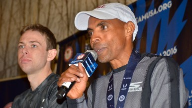 With race winner Galen Rupp beside him, Meb Keflezighi speaks at post-marathon news conference. Photo by Ken Stone