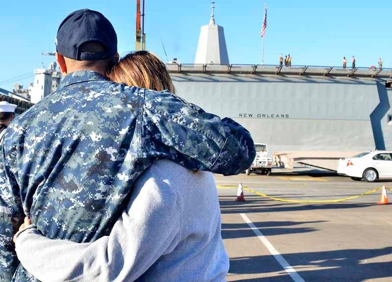 Couple hugs before deployment