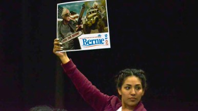 Bernie Sanders is depicted as an action hero in one sign. Photo by Chris Stone