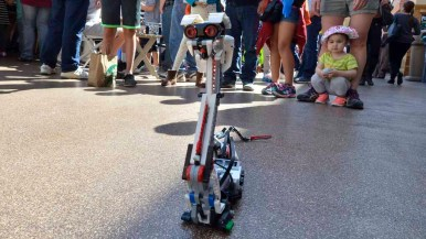 Young people and adults delighted in robots turned loose at the science and engineering festival. Photo by Chris Stone