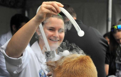Nathalie Staiger from Mad Science drops soapy liquid nitrogen on a boy's hair. Photo by Chris Stone