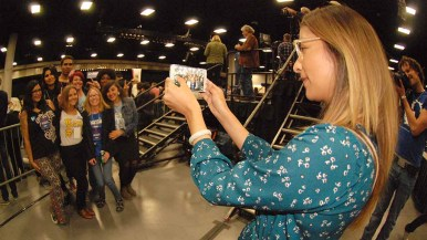 Some members of the press couldn't resist recording the monent. Photo by Ken Stone