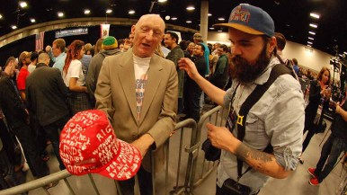 John Braehler, 71, shows off his hat to a member of the press. Photo by Ken Stone