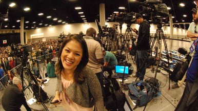Reporter Candace Nguyen of NBC 7 San Diego smiles while waiting for Bernie Sanders' arrival. Photo by Ken Stone