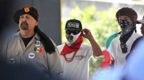 Members of Aztlan Tierra Liberacion Revolucion spoke at Chicano Park Day. Photo by Chris Stone