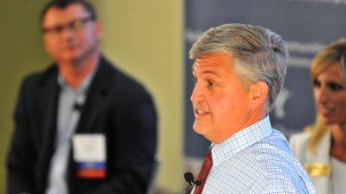 Incumbent Dave Roberts speaks at debate as moderator Charlie Piscitello looks on. Photo by Ken Stone