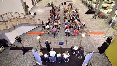 About 90 people attended debate at Petco corporate headquarters in Rancho Bernardo. Photo by Ken Stone