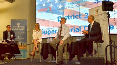 Charlie Piscitello, Petco's chief people officer, shares a light moment with the District 3 candidates. Photo by Ken Stone