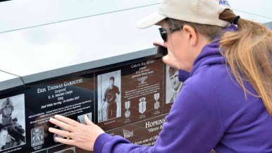 Gail Duffey from San Diego get emotional as she reads the plaques at Mt. Soledad National Veterans Memorial. Photo by Chris Stone