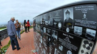 People streamed up to Mt. Soledad in La Jolla to show their respect to fallen servicemen. Photo by Chris Stone