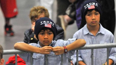Young boys wear Trump hats in the San Diego Convention Center during Donald Trump's speech. Photo by Chris Stone