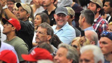 Donald Trump fans laugh at a remark in Trump's speech. Photo by Chris Stone
