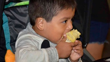 Isaac Leon, 3, loves corn at the county fair. Photo by Chris Stone