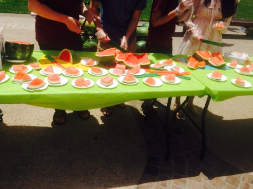 Students form a huge line in Revelle college to eat freshly sliced watermelon. Photo Credit: Cassia Pollock