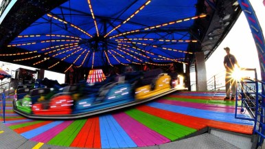 Fairgoers headed to the rides in the Fun Zone at the San Diego County Fair. Photo by Chris Stone