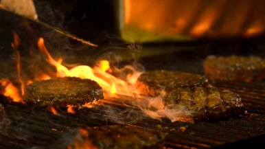 Burgers are grilled on the first night of the San Diego County Fair. Photo by Chris Stone