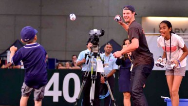 As Padres All-Star Wil Myers aims to throw a foam ball, a ball fires back at the All-Star FanFest. Photo by Chris Stone