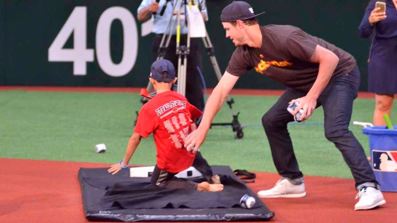 Padre Wil Myers took part in a FanFest clinic in which he tagged kids who slid into base. Photo by Chris Stone