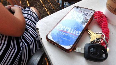 A young woman's smart phone declared allegiance to Bernie Sanders. Photo by Ken Stone