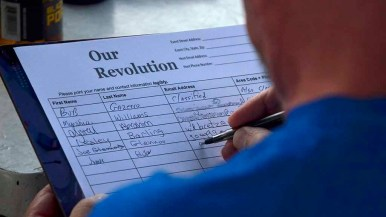 """Nearly two dozen people attended the El Cajon viewing party, where people signed up for """"Our Revolution."""" Photo by Ken Stone"""