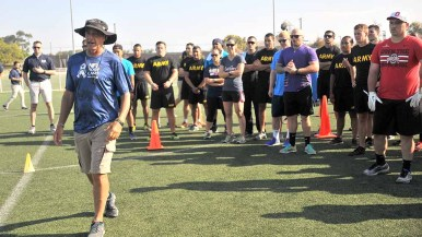 NFL rep greets service members at NFL Boot Camp at Marine Corps Air Station Miramar. Photo by Chris Stone