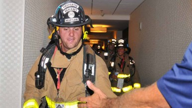 Heartland fireman Brackney gets encouragement on the 30th floor of the hotel. Photo by Chris Stone