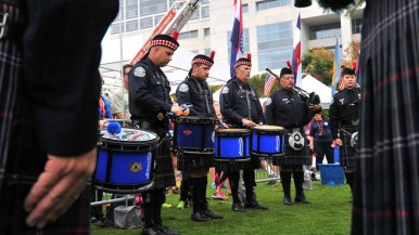 Members of the Emerald Society San Diego Firefighters Pipes and Drums pause during ceremony. Photo by Chris Stone