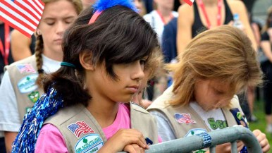 Girl Scouts listen as a speaker tells his experiences on 9/11. Photo by Chris Stone