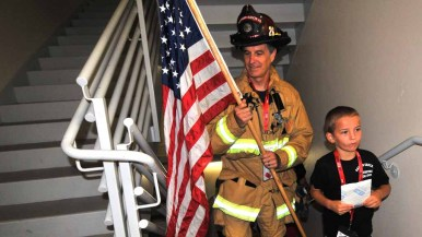 Members of the Rancho Santa Fe Fire District were the first to head up the stairs. Photo by Chris Stone