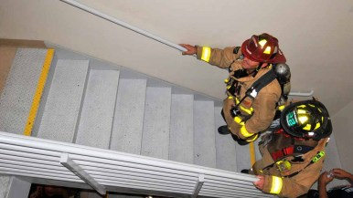 Firefighters make it to the 30th floor of the Hilton Bayfront Hotel. Photo by Chris Stone