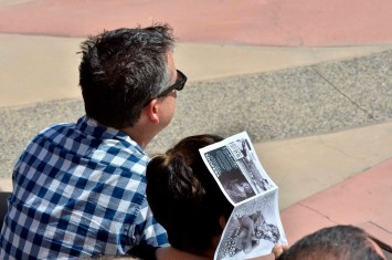 """The sun broke out and spectators used programs for shade at San Diego Opera's young artists performance of """"Cinderella."""" Photo by Chris Stone"""