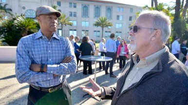 Local organizing group Willie Banks (left) listens to an attendee at the World Beach Games update event. Photo by Ken Stone