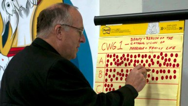 Bishop McElroy tallies the delegate's priorities at the San Diego snyod at diocesan headquarters. Photo by Chris Stone