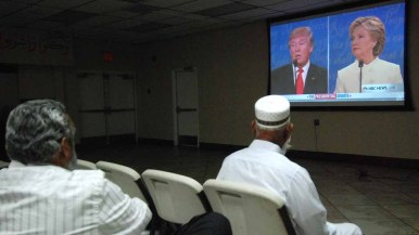 After prayers, refugees and other immigrants gathered to watch third presidential debate. Photo by Chris Stone