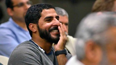 At Islamic Center of San Diego, a man laughs as Donald Trump speaks during third debate. Photo by Chris Stone