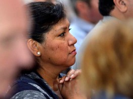 Parishioners and delegates pray during Mass at the San Diego synod. Photo by Chris Stone