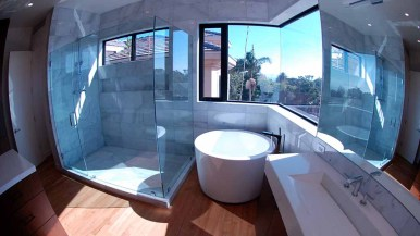 Shades can be drawn for privacy in the ocean-view bathroom of the Taft Avenue home in Bird Rock. Photo by Ken Stone
