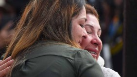 Edith Hernandez hugs her mother, Maria Plata-Colin. Photo by Chris Stone
