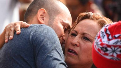 Adrian Gonzalez-Morales holds on to his mother, Martha Morales. Photo by Chris Stone